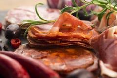 A pile of different spanish embutido, jamon, chorizo and lomo em Stock Photo