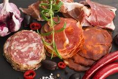 A pile of different spanish embutido, jamon, chorizo and lomo em Royalty Free Stock Photo