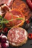 A pile of different spanish embutido, jamon, chorizo and lomo em Stock Photography
