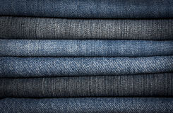 A pile of different types of blue denim jeans clos Royalty Free Stock Photo