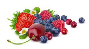 Pile of different wild berries isolated on white background with clipping path. Various type of berry fruits, collection. Pile of different wild berries with royalty free stock image