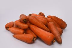 A pile of dirty carrots, pulled out of the ground and washed. Pile of dirty carrots, pulled out of the ground and washed Royalty Free Stock Photos