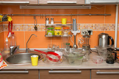 A pile of dirty dishes in kitchen. A pile of dirty dishes in the kitchen stock photography