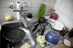 Pile of dirty dishes in the metal sink Stock Images