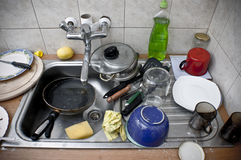 Pile of dirty dishes in the metal sink Royalty Free Stock Photos