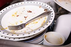Pile of dirty dishes in the sink royalty free stock photo