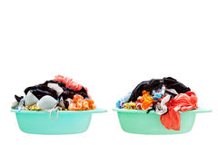 Pile of dirty laundry in a washing basket on a white background. Royalty Free Stock Photography