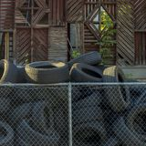 Pile of discarded black tires on a sunny day royalty free stock photos