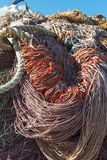 Stack of discarded fishing nets ropes Stock Images