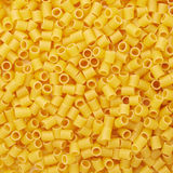 Pile of ditalini yellow pasta as abstract background Royalty Free Stock Image