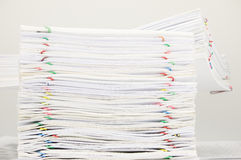 Pile of document with colorful paper clip on finance account. Place on white table Royalty Free Stock Photos