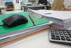 Pile of document and stationery on desk Stock Image