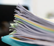 Pile of documents and blue file in office Royalty Free Stock Photography