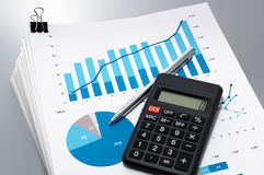 Pile of documents, calculator and pen. Royalty Free Stock Photo