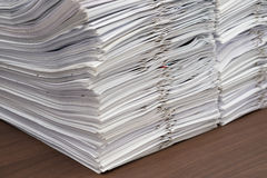 Pile of documents with clips on desk royalty free stock photo