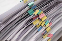 Pile of documents with colorful clips Royalty Free Stock Images