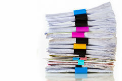 Pile of documents with colorful clips on white Stock Image