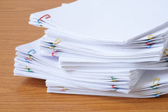 Pile of documents with colourful clips. On the wood table stock image