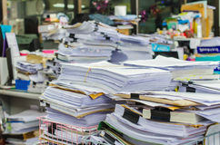 Pile of documents on desk stack up high waiting to be managed Royalty Free Stock Photography