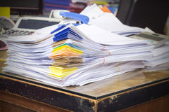 Pile of documents on desk stack Stock Photos