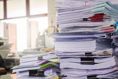 Pile of documents on desk. Stack up high waiting to be managed stock image