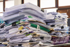 Pile of documents on desk. At workplace stock photo
