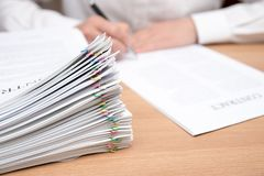 A pile of documents with the man stock photography