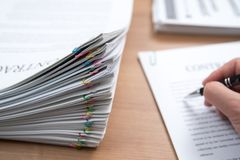 A pile of documents with the man stock images