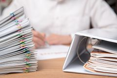 A pile of documents with the man stock photo
