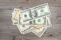 Pile of dollar bank notes. Pile of bank notes on old wooden desk Stock Photos