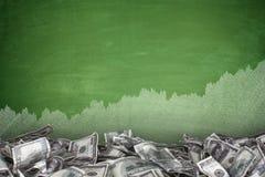Pile of dollar bills on blackboard background Стоковая Фотография RF