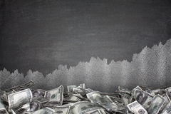 Pile of dollar bills on blackboard background Stock Photography