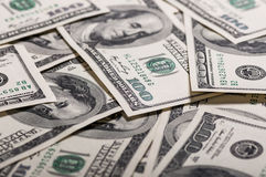 A pile of dollar bills. A pile of hundred dollar bills stock images