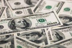 A pile of dollar bills. A pile of hundred dollar bills royalty free stock photos