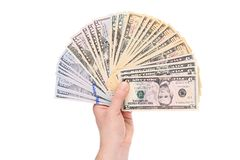 Pile of dollars banknotes in hand. Royalty Free Stock Image