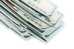 100 dollar bills. Pile of 100 dollars bills on white background Royalty Free Stock Images