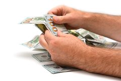 Pile of dollars, counting Royalty Free Stock Photography