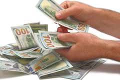 Pile of dollars, counting Royalty Free Stock Images