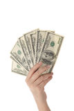 Pile of dollars in female hand (isolated) Royalty Free Stock Images