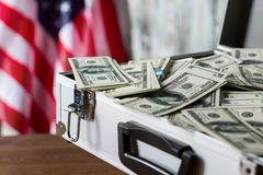 Pile of dollars in suitcase. Royalty Free Stock Image
