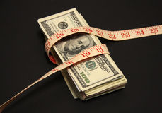 A pile of dollars with tape measure background Royalty Free Stock Photography