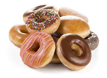 Pile of Donuts on White Background royalty free stock images