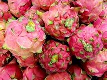 Pile of dragon fruits. Full frame of dragon fruits at market royalty free stock photos