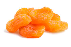 A pile of dried apricots isolated. With a light shadow stock images