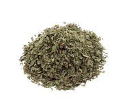 A pile of dried basil leaves Stock Photos
