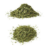 Pile of dried coriander isolated. Pile of dried coriander chinese parsley seasoning isolated over the white background, set of two different foreshortenings Royalty Free Stock Images