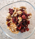 Pile Of Dried Cranberries and Walnuts Royalty Free Stock Photos