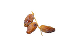 Pile of dried date fruits isolated on white background. Royalty Free Stock Photo