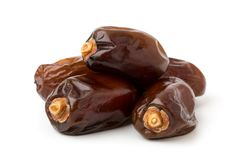 Pile of dried dates on a white. Background, close up royalty free stock images
