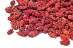 Dried goji berries. A pile of dried goji berries on a white background Royalty Free Stock Images
